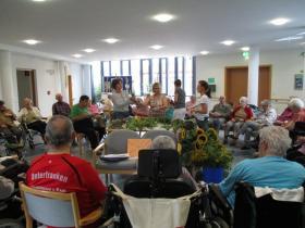 71_2017-08-23__ac1ba1d8___Kraeuterbueschel_binden_2017___Copyright_Caritasverband_fuer_den_Landkreis_Hassberge_e_V_